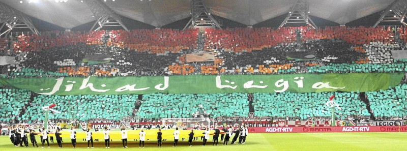 """File photo of Legia Warszawa soccer fans displaying a banner with the words """"Jihad Legia"""" at Pepsi Stadium in Warsaw"""